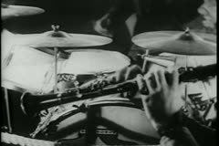 Medium shot of hands playing drums and clarinet - stock footage