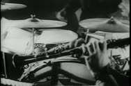 Stock Video Footage of Medium shot of hands playing drums and clarinet