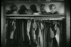 Opened closet with 1940s clothes, shoes and hats Stock Footage