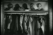 Stock Video Footage of Opened closet with 1940s clothes, shoes and hats
