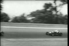 Race car overtaking another, Indianapolis Motor Speedway USA Stock Footage