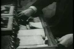 Close-up of hands pulling out map from drawer and unfolding it Stock Footage