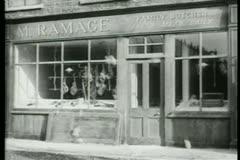 People throwing stones through butcher shop window Stock Footage
