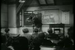 School teacher drawing on blackboard Stock Footage