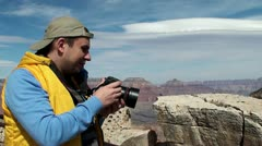 A tourist is photographing the Grand Canyon (Arizona, USA) - stock footage