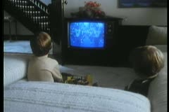 Children watching parade on television Stock Footage