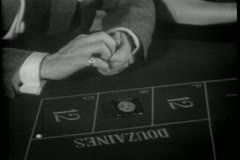 Close-up of hands placing bet then changing it Stock Footage