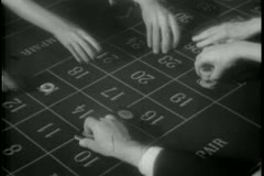 People placing bets at roulette table Stock Footage