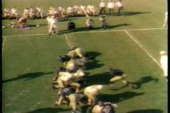 Football players tackling during game Stock Footage