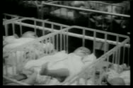 Stock Video Footage of Rows of babies in cribs in hospital