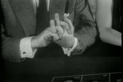 Close-up of nervous man's hands as he loses at roulette table - stock footage