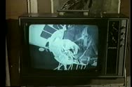 Close-up of TV screen broadcasting astronaut in space Stock Footage