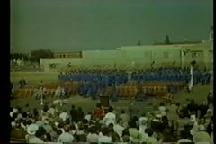 Wide shot of students attending high school graduation Stock Footage