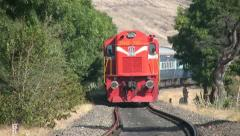 Indian railways passenger train passes by in a mountainous countryside. Stock Footage