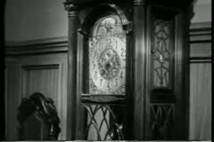 Zoom in to grandfather clock face at 7:30 Stock Footage