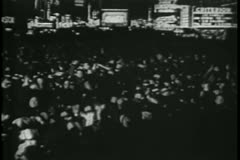 Crowd celebrating  on New Year's Eve, 1930s - stock footage