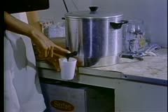 Close-up of hands pouring coffee out of an urn Stock Footage