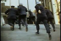 Policemen running up stairs Stock Footage