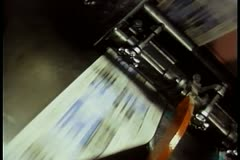 Newspapers printing during press run at printing plant - stock footage