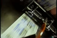 Stock Video Footage of Newspapers printing during press run at printing plant