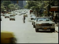 Sniper shooting at bike rider and people on city street - stock footage