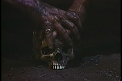 Dirty hands on skull Stock Footage