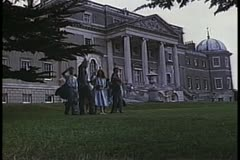 Tourists waving in front of Wrotham Park, Hertfordshire Stock Footage