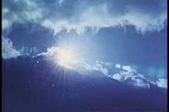 Wide shot of sun moving behind clouds - stock footage