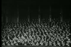 Audience in theater applauding - stock footage