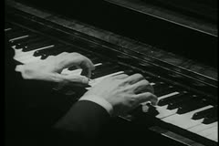 Close-up of trembling hands attempting to play piano Stock Footage