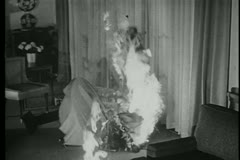 Fire igniting curtains in room - stock footage