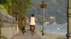 Woman biking with dog Stock Footage