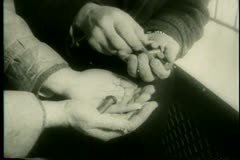 Close-up of hands counting pieces of hardware - stock footage