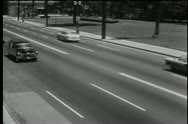 1950s hearse traveling down road Stock Footage