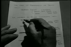Close-up of hands crossing out names on emergency contact list Stock Footage