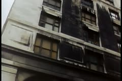 Panning up burned building Stock Footage