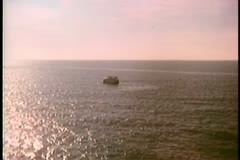 Zoom in to yacht on open sea - stock footage