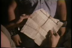 Close-up of hands holding newspaper article about kidnapped boy Stock Footage