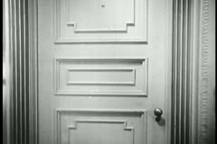 Zoom out white door and zoom in to another white door Stock Footage