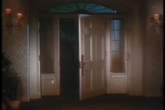 Wide shot of front door opening by itself Stock Footage