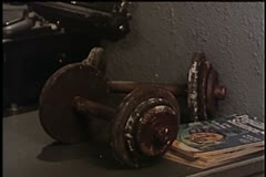 Close-up of table with weights, typewriter and telephone Stock Footage