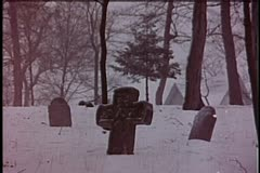 Wide shot of men carrying coffin through cemetery in winter Stock Footage
