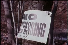 Close-up of no trespassing sign on tree Stock Footage