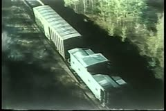 High angle view of freight train traveling through country side Stock Footage