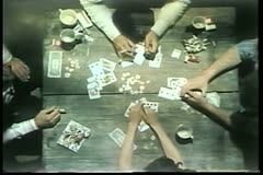 High angle view of people playing cards on wooden table - stock footage