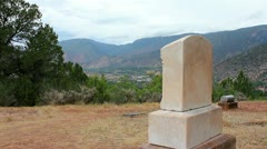 Old tombstone with beautiful valley and mountains in background Stock Footage
