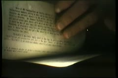 Close-up of hand searching through papers - stock footage