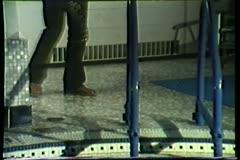Man sneaking python into swimming pool Stock Footage
