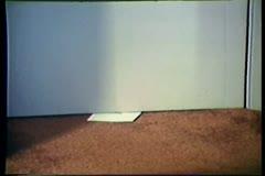Close-up of envelope retrieved from under door Stock Footage