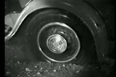 Close-up of spinning car tire stuck in mud Stock Footage